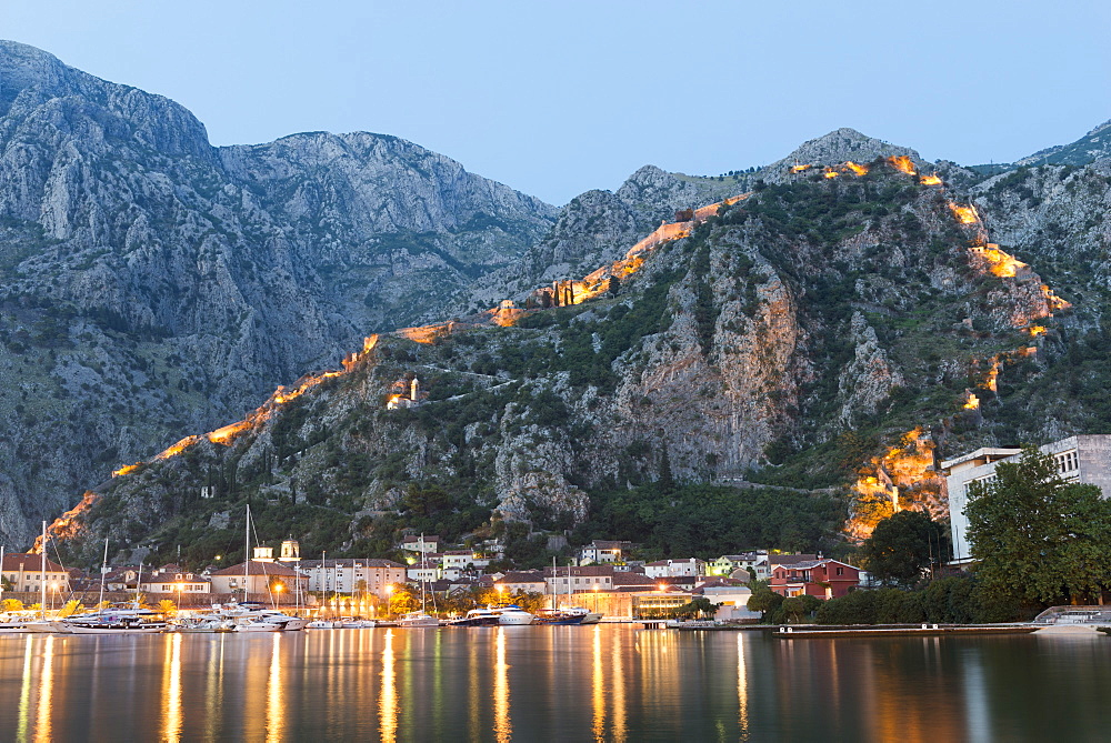Venetian built fort with bastions highlighted by lights at twilight, Kotor, Montenegro, Europe - 737-701