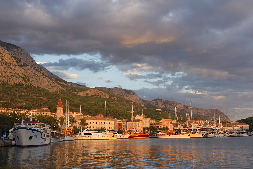 Old town has many Venetian style houses and boats in harbour, Makarska, Croatia.