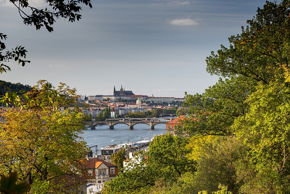 Prague Castle and Mala Strana suburb from Vysehrad Castle with Vltava River and bridges.