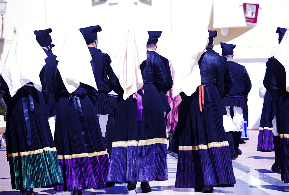Men & Women in a traditional costume during the Saint Antioco procession Sardinia
