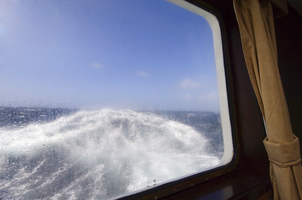 View from the cabin of the Antarctic Dream navigation in rough seas near Cape Horn, Drake Passage, Antarctic Ocean, South America