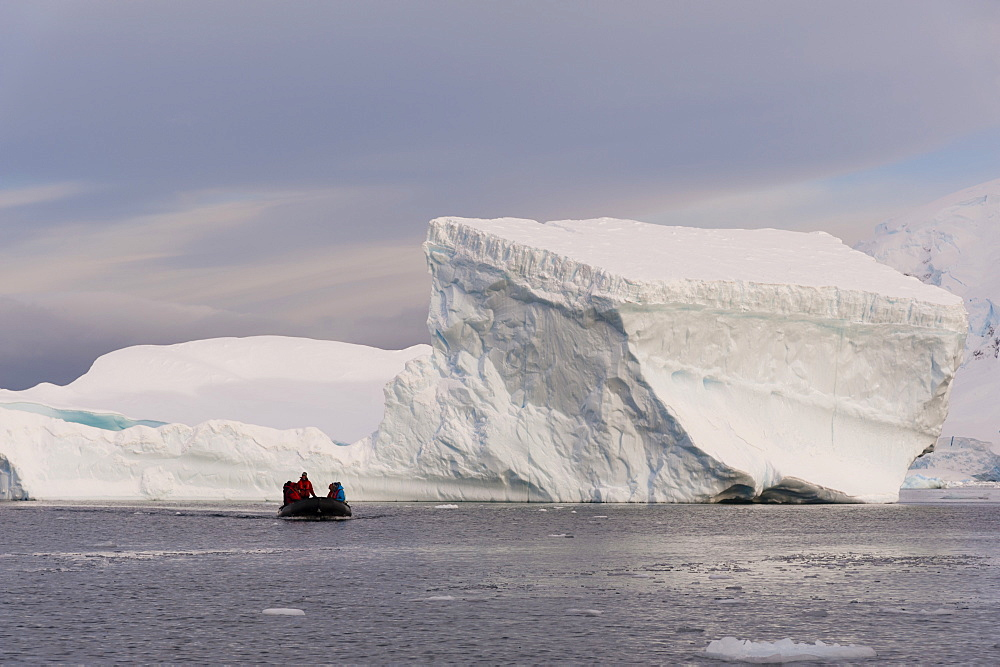 Tourists exploring Skontorp Cove in inflatable boat, Paradise Bay, Antarctica, Polar Regions
