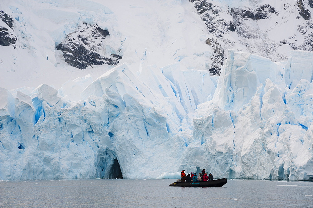 Tourists at the edge of ice shelf, Skontorp Cove, Paradise Bay, Antarctica, Polar Regions