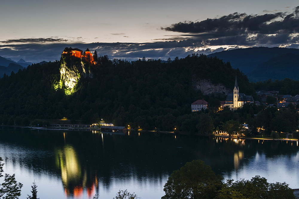 Bled Castle and St. Martin's Church at dusk, Lake Bled, Slovenia, Europe