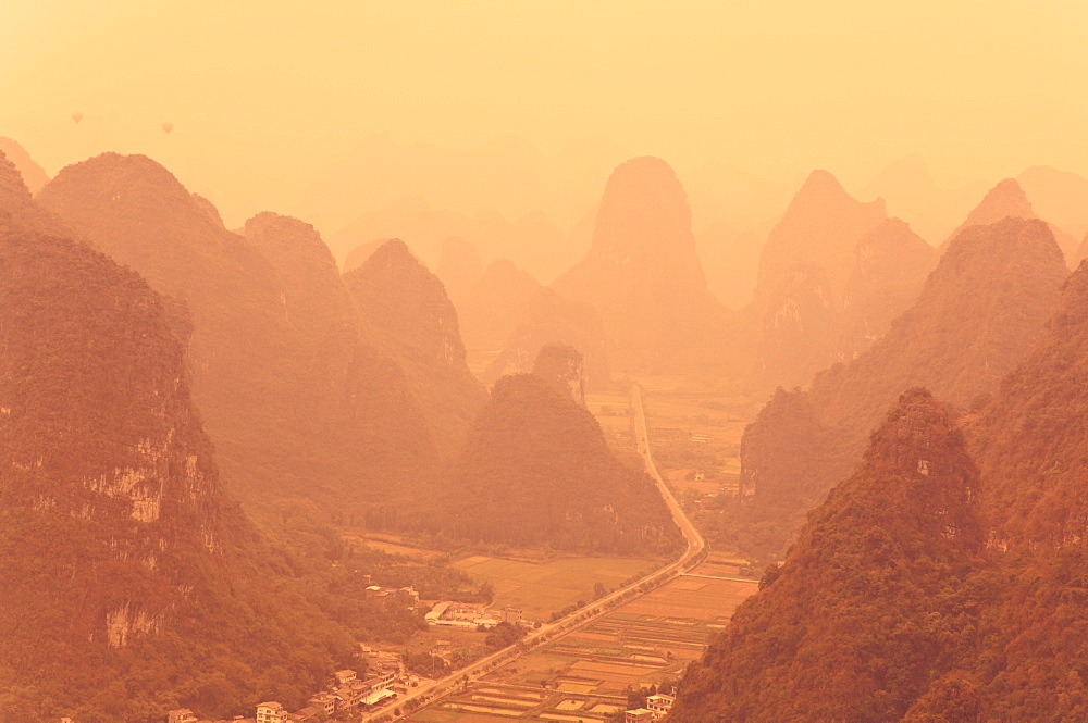 Karst landscape and morning haze, Yangshuo, Guangxi Province, China, Asia - 756-19