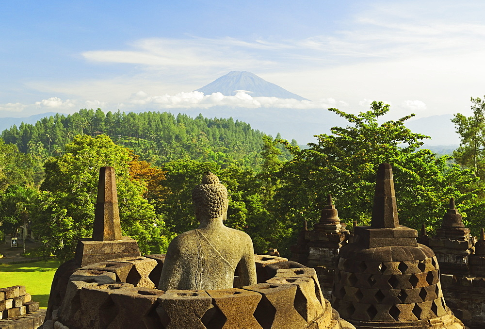Borobodur, UNESCO World Heritage Site, with Mount Merapi in the distance, Kedu Plain, Java, Indonesia, Southeast Asia, Asia