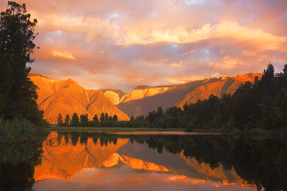 Sunset, Lake Matheson and Southern Alps, Westland, South Island, New Zealand, Pacific