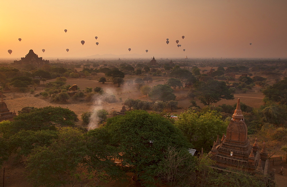Hot air balloons at sunrise above Bagan (Pagan), Myanmar (Burma), Asia