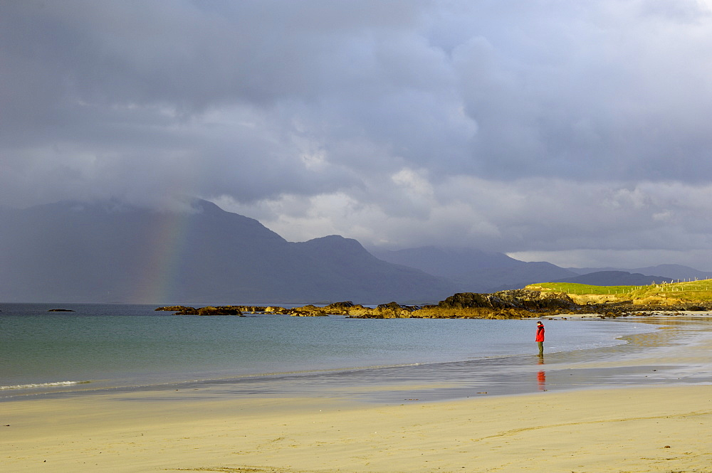 Lone person on a sandy beach under a stormy sky, near Tully Cross, Connemara, County Galway, Connacht, Republic of Ireland, Europe