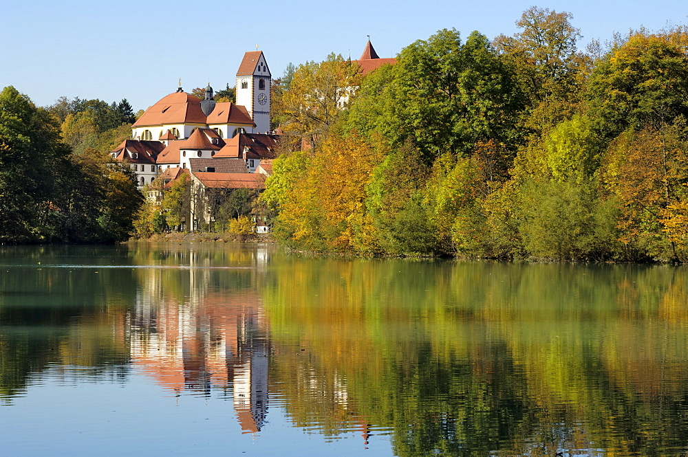 St. Mang Monastery and Basilica reflected in the river Lech, Fussen, Bavaria (Bayern), Germany, Europe