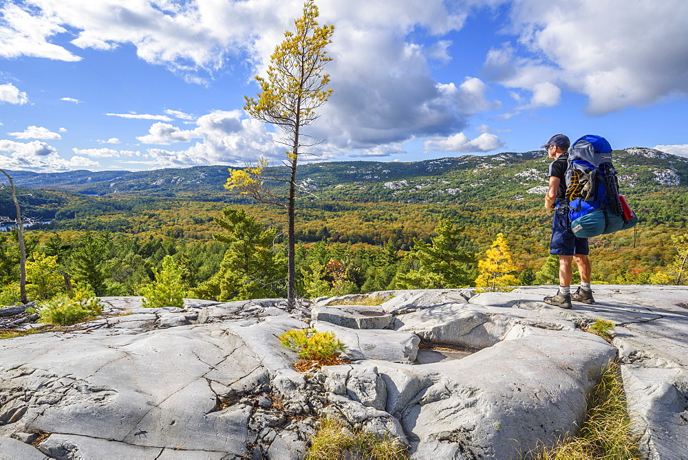 Hiker on La Cloche Silhouette Trail in Killarney Provincial Park, Ontario, Canada, North America