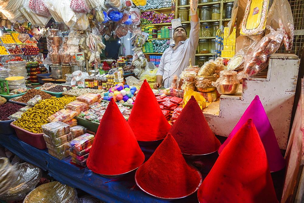 Vendor at food and spice stall at K. R. Market in Banaglore, Karnataka, India, Asia
