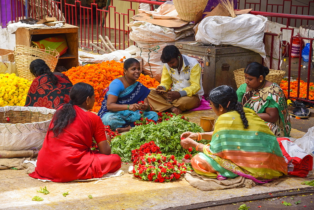 Women working at flower stall at K. R. Market in Banaglore, Karnataka, India, Asia