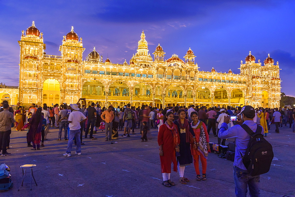 Family posing for photograph at Mysore Palace in Mysuru, Karnataka, India, Asia