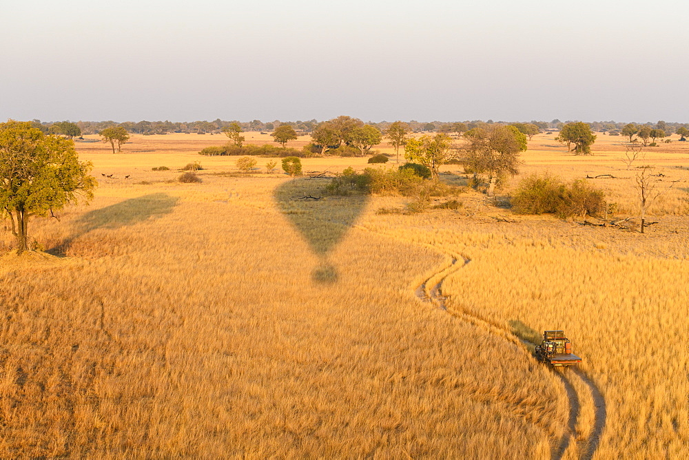 Aerial view of the Okavango Delta from a hot air balloon ride including chase vehicle, Okavango Delta, Botswana, Africa - 762-875