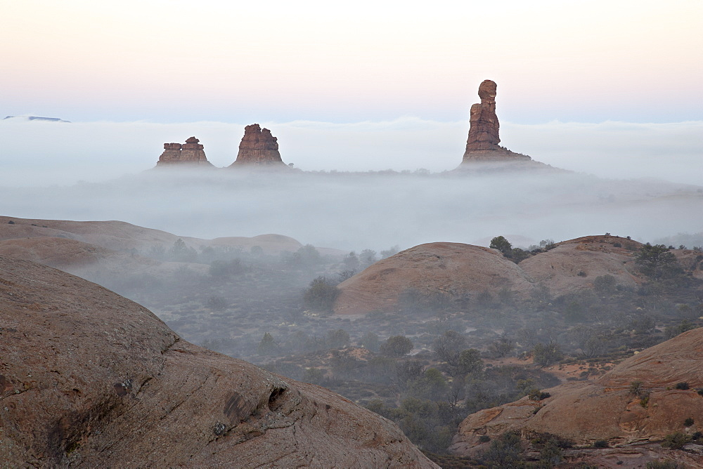 Balanced Rock on a foggy morning at sunrise, Arches National Park, Utah, United States of America, North America