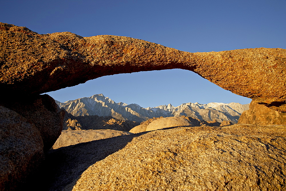 Lathe Arch framing Mount Whitney at first light Alabama Hills, Inyo National Forest, California, United States of America, North America