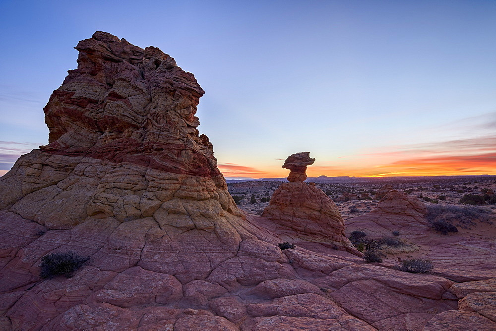 Sandstone formation at dawn with orange clouds, Coyote Buttes Wilderness, Vermilion Cliffs National Monument, Arizona, United States of America, North America