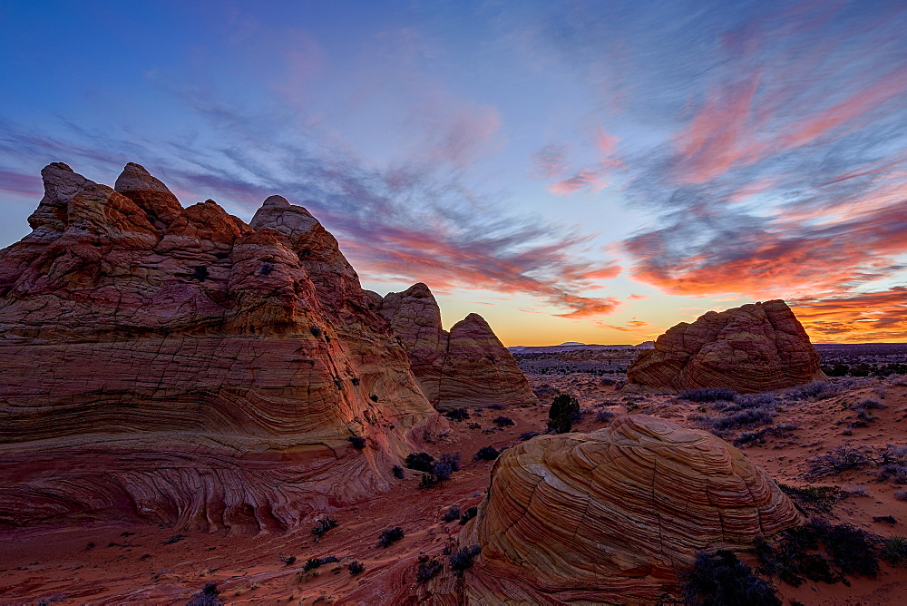 Orange clouds over sandstone cones, Coyote Buttes Wilderness, Vermilion Cliffs National Monument, Arizona, United States of America, North America