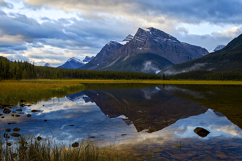 Mountain reflected in Waterfowl Lake at sunrise, Banff National Park, UNESCO World Heritage Site, Alberta, Rocky Mountains, Canada, North America