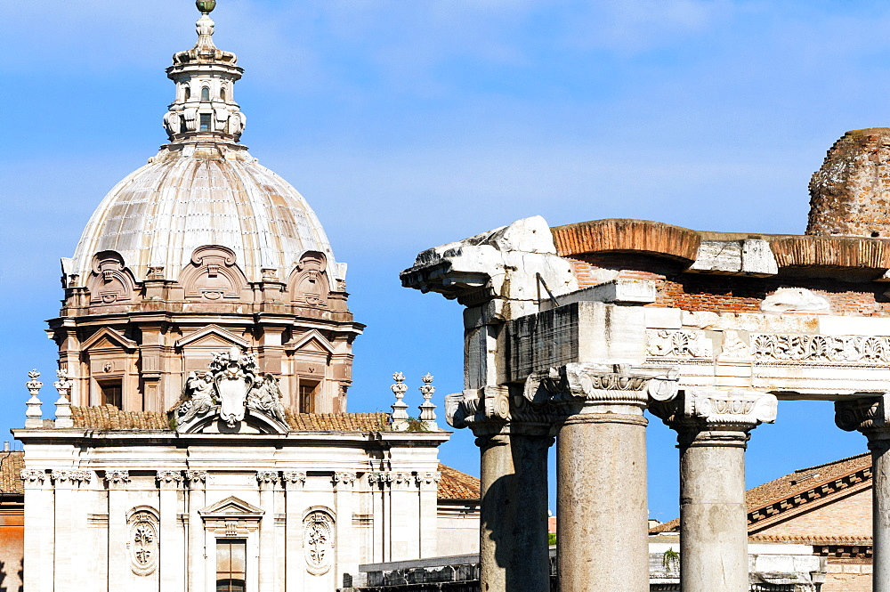 Roman Forum with Temple of Saturn, and the dome of Santi Luca e Martina behind, Rome, UNESCO World Heritage Site, Lazio, Italy, Europe