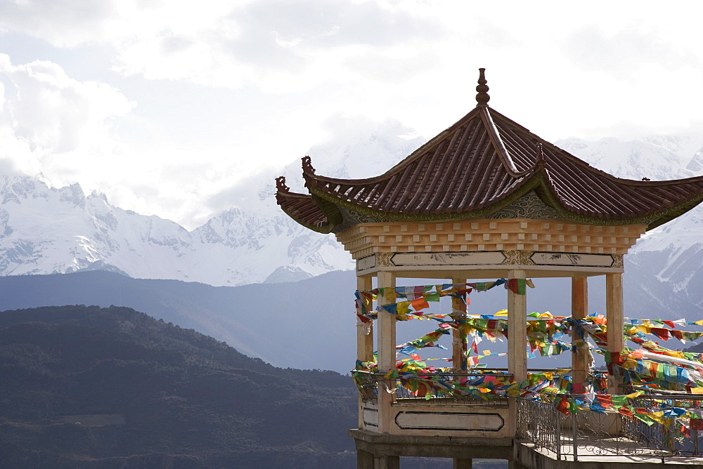 Buddhist stupa on way to Deqin, on the Tibetan Border, with the Meili Snow Mountain peak in the background, Dequin, Shangri-La region, Yunnan Province, China, Asia