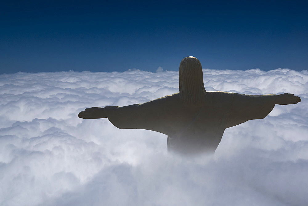 Statue of Christ the Redeemer rising above the clouds, Corcovado, Rio de Janeiro, Brazil, South America - 772-3484