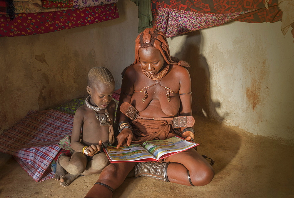Himba woman and child reading, Kaokoland, Namibia, Africa - 772-3640