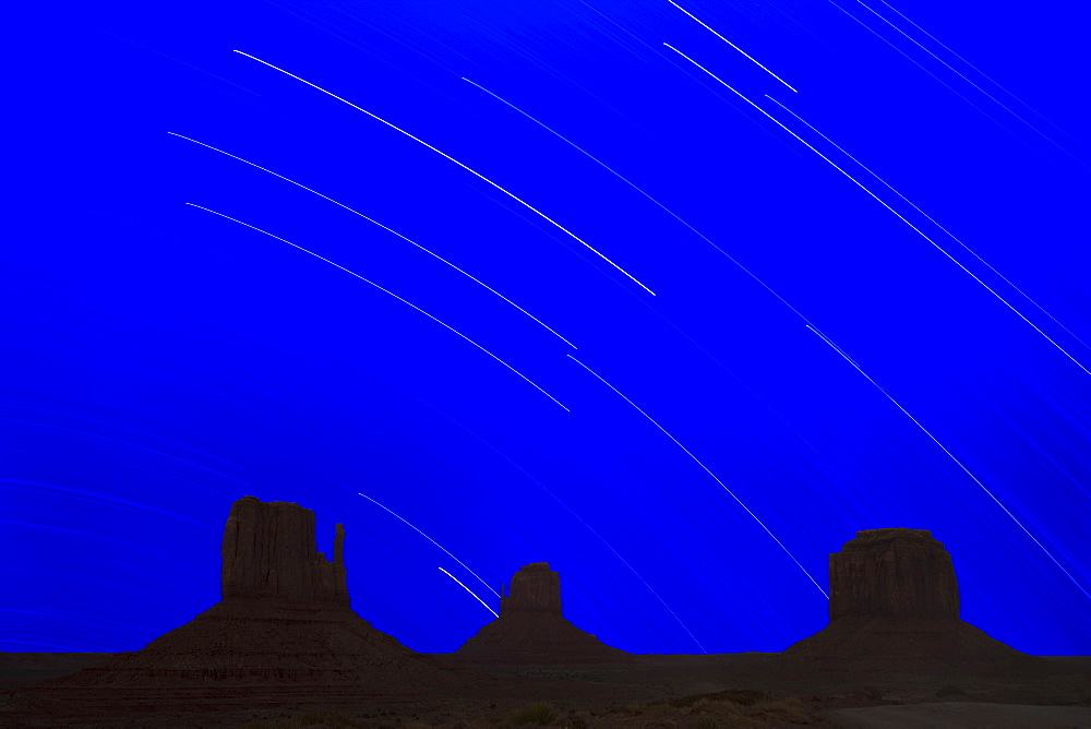 Long explosure resulting in star stripes in sky, Monument Valley Navajo Tribal Park, Arizona Utah border, United States of America, North America