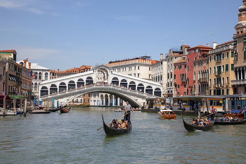 Gondolas by Rialto Bridge in Venice, Italy, Europe