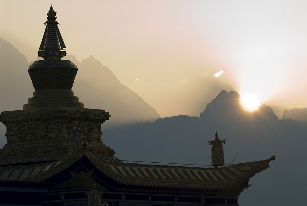 Buddhist temple at dawn with mountains beyond, Snow mountain, Tagong Grasslands, Sichuan, China, Asia - 784-52