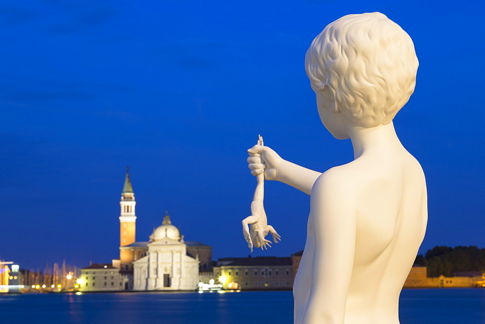 Night shot of Boy with Frog statue by Charles Ray, outside Dogana di Mare, with San Giorgio Maggiore in the distance, Venice, UNESCO World Heritage Site, Veneto, Italy, Europe - 785-1595