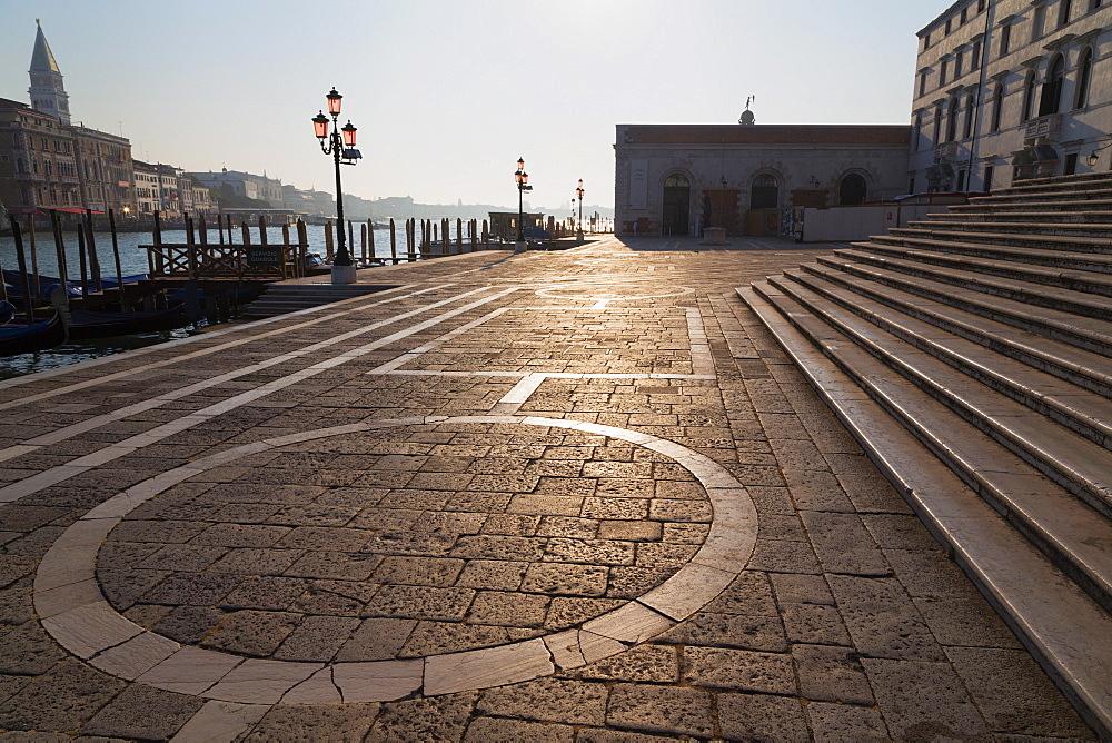 Campo della Salute and the steps of Santa Maria della Salute on the Grand Canal in early morning light, Venice, UNESCO World Heritage Site, Veneto, Italy, Europe