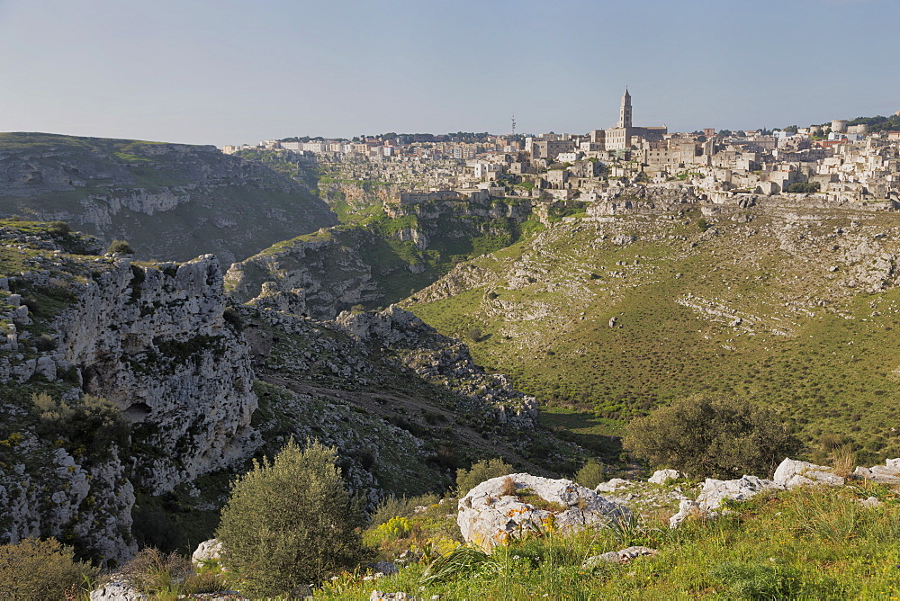 View of the ravine and the Sassi area of Matera with Matera Cathedral, Basilicata, Italy, Europe