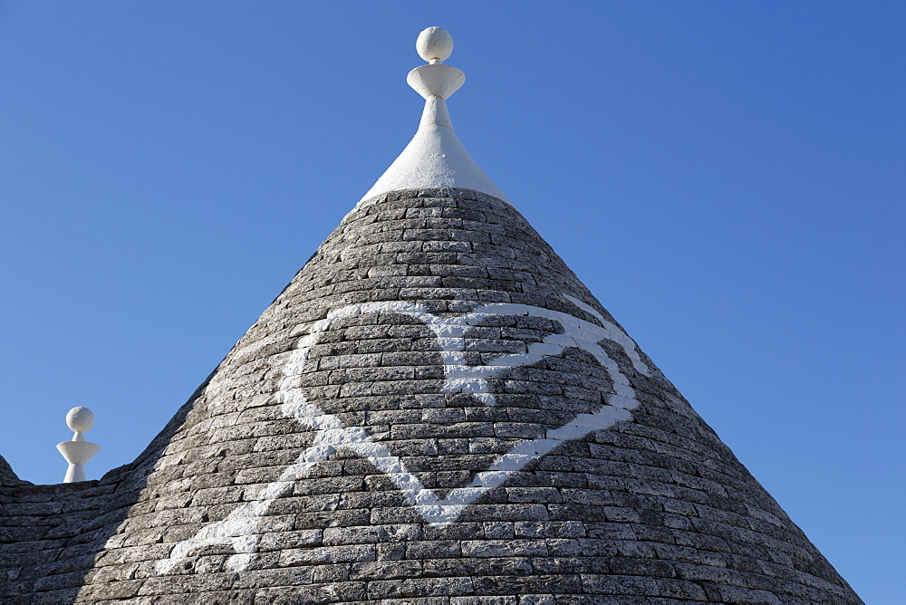 Heart painted on roof of traditional trullo in Alberobello, UNESCO World Heritage Site, Puglia, Italy, Europe