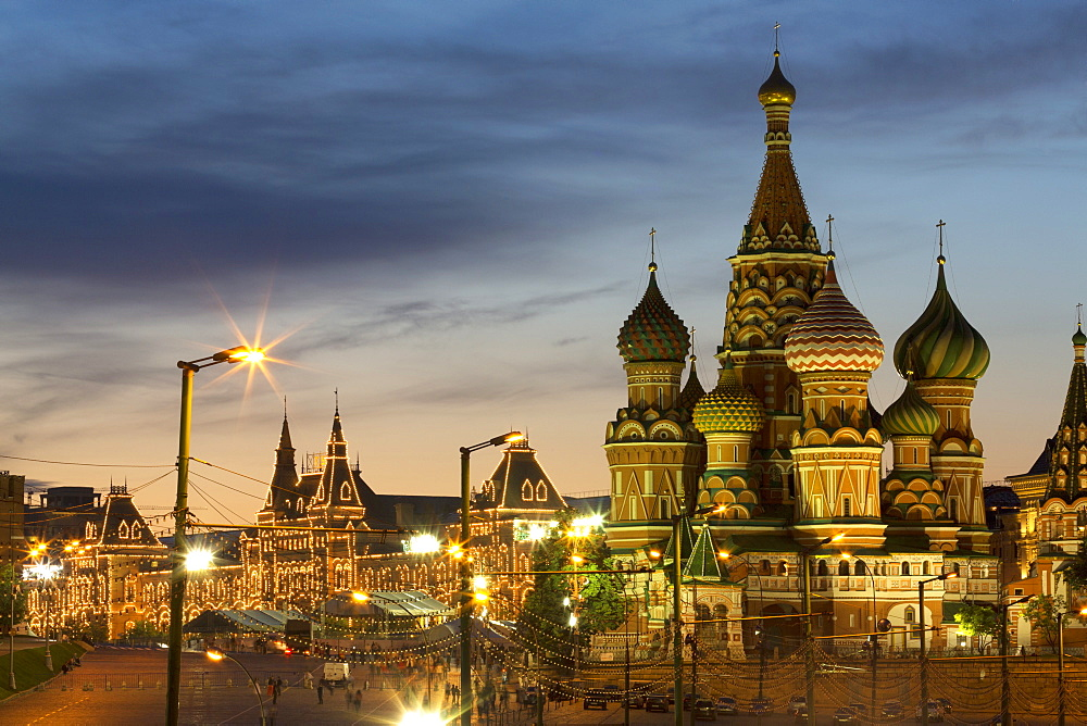 Gum department store and the onion domes of St. Basil's Cathedral in Red Square illuminated at night, UNESCO World Heritage Site, Moscow, Russia, Europe