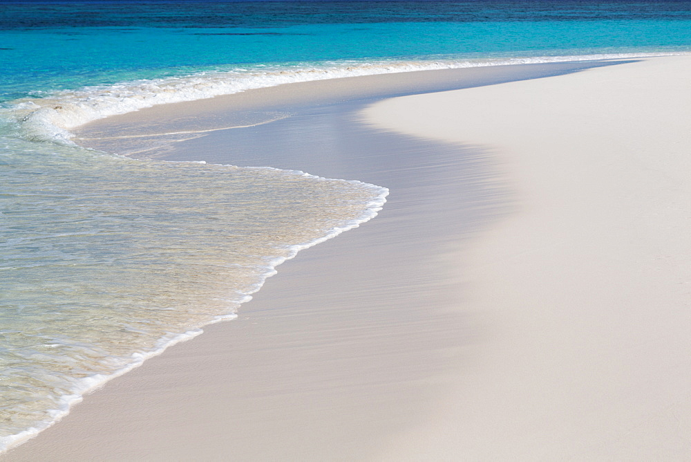 The crystal clear water of the Indian Ocean and a deserted beach on an island in the Maldives, Indian Ocean, Asia