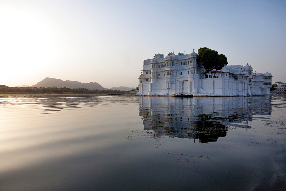 Perfect reflection of Lake Palace Hotel, situated in the middle of Lake Pichola, in Udaipur, Rajasthan, India, Asia