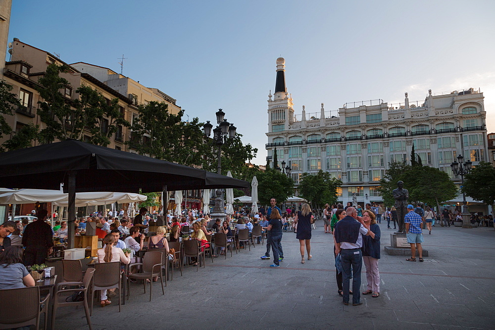 People relaxing in in the evening in Plaza de Santa Ana in Madrid, Spain, Europe