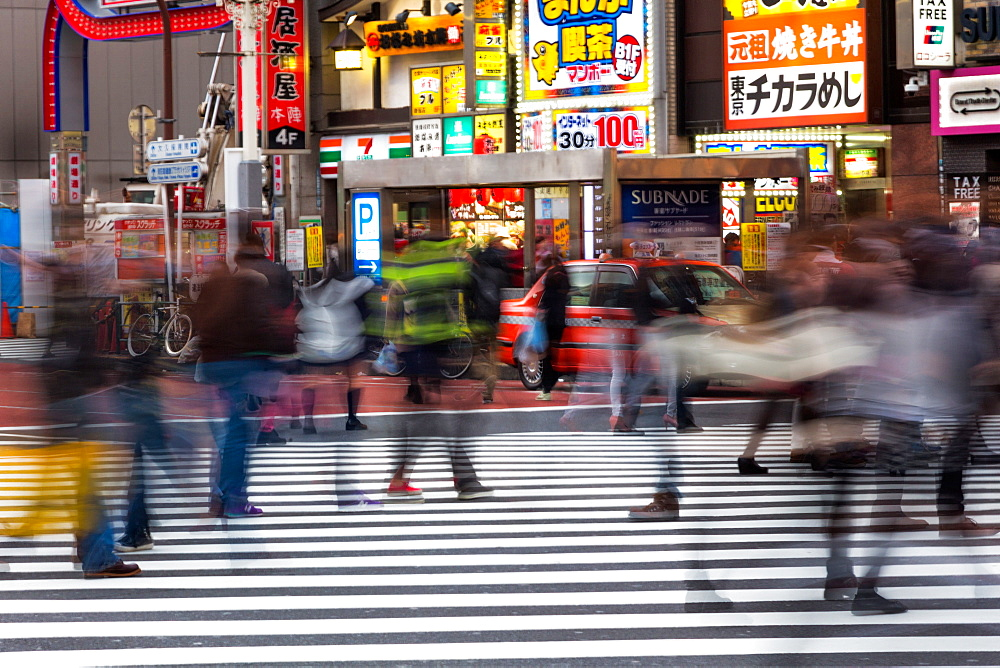 Crowds crossing a street in the Ginza district in the evening, Tokyo, Japan, Asia