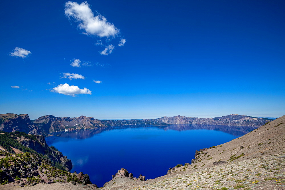 The still waters of Crater Lake, the deepest lake in the U.S.A., part of the Cascade Range, Oregon, United States of America, North America