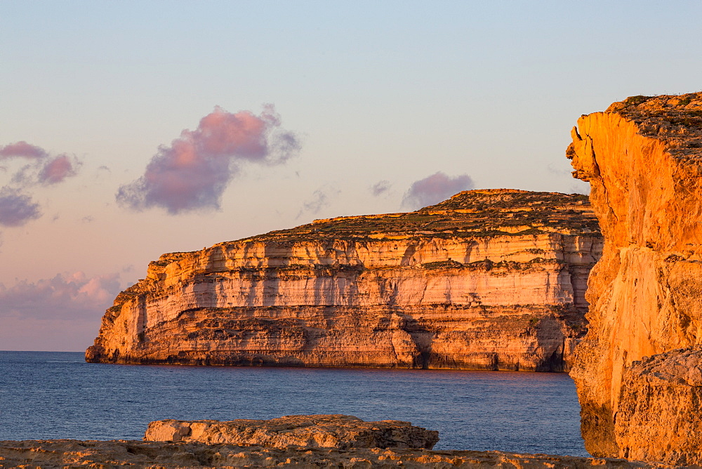 Dwejra Bay on the rugged Gozo coast in evening light, site of the fallen Azure Window, Gozo, Malta, Mediterranean, Europe