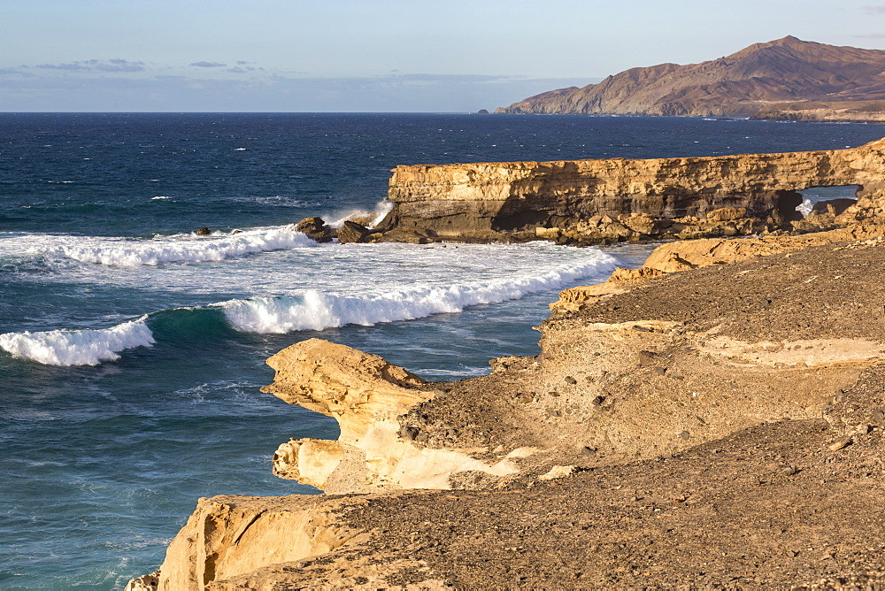 Surf and natural arch on Playa La Pared on the volcanic island of Fuerteventura, Canary Islands, Spain, Atlantic, Europe - 785-2259