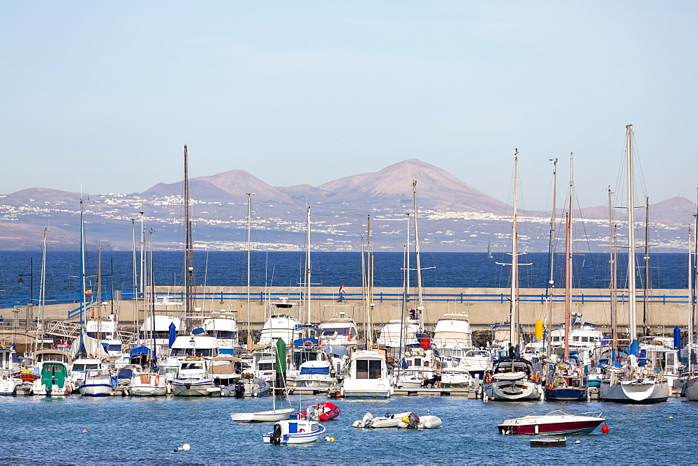 The harbour at Corralejo on the island of Fuerteventura with Lanzarote in the distance, Fuerteventura, Canary Islands, Spain, Atlantic, Europe - 785-2269
