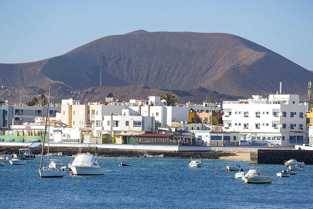 The waterfront of old town Corralejo on the island of Fuerteventura with a volcano in the distance, Fuerteventura, Canary Islands, Spain, Atlantic, Europe - 785-2285