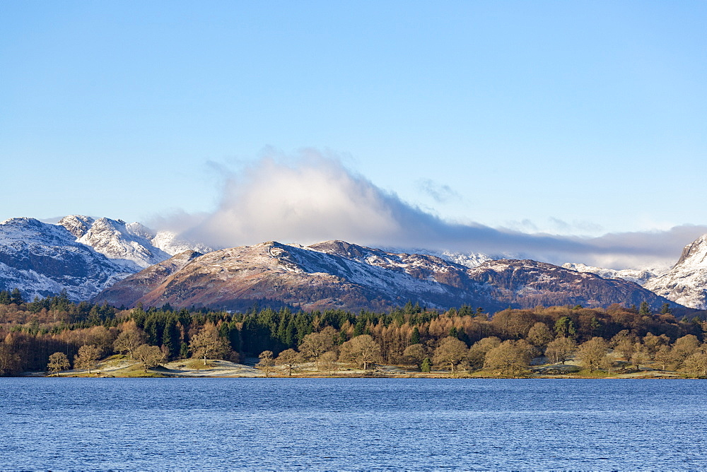 Looking towards the north end of Windermere near Ambleside, with rugged snow covered mountains including Helvellyn, Lake District National Park, UNESCO World Heritage Site, Cumbria, England, United Kingdom, Europe - 785-2325