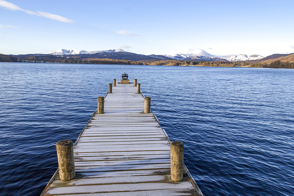 Frost covered jetty at the north end of Windermere near Ambleside, with rugged snow covered mountains including Helvellyn, Lake District National Park, UNESCO World Heritage Site, Cumbria, England, United Kingdom, Europe - 785-2326