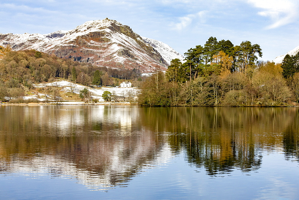 A perfect reflection of snow covered mountains and sky in the still waters of Grasmere, Lake District National Park, UNESCO World Heritage Site, Cumbria, England, United Kingdom, Europe - 785-2329