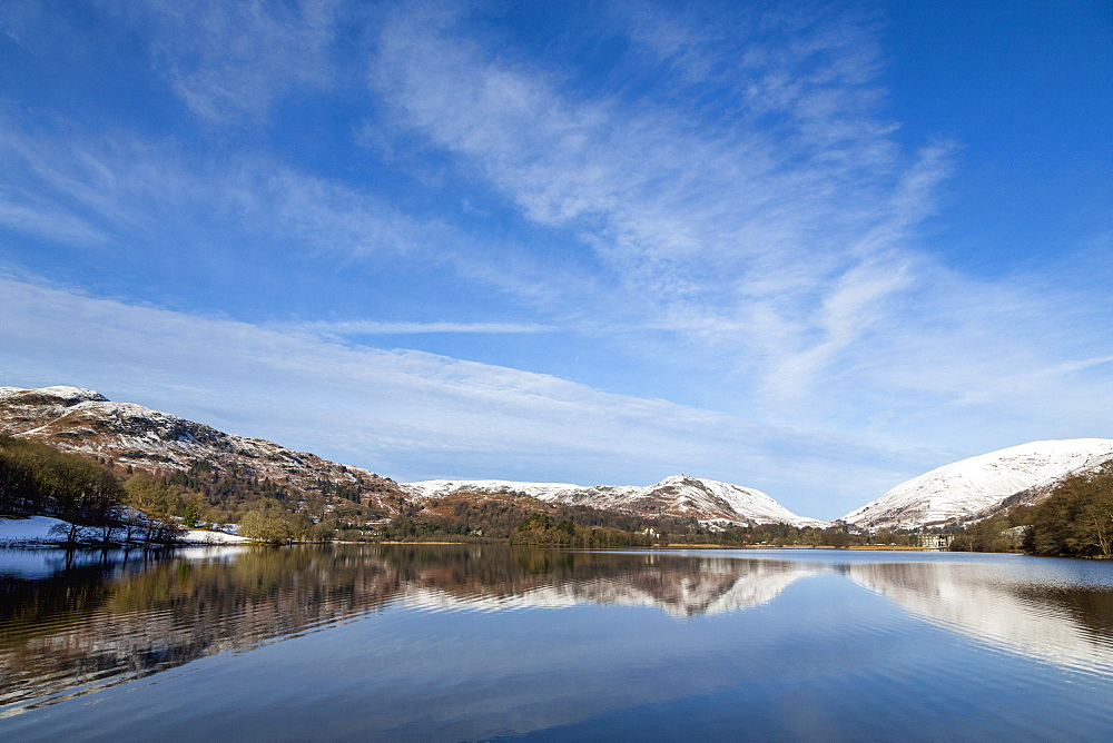 A perfect reflection of snow covered mountains and sky in the still waters of Grasmere, Lake District National Park, UNESCO World Heritage Site, Cumbria, England, United Kingdom, Europe - 785-2330