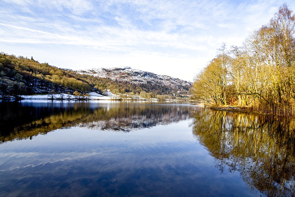 A perfect reflection of snow covered mountains and sky in the still waters of Grasmere, Lake District National Park, UNESCO World Heritage Site, Cumbria, England, United Kingdom, Europe - 785-2331